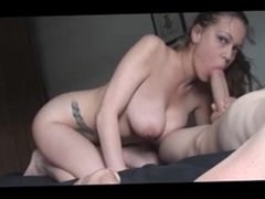 Busty tattoed amateur gives a great blow- and handjob
