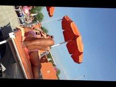 Milf in bikini at swimming pool