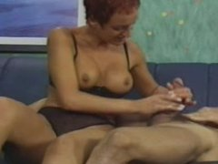 Short Haired Lady Giving Handjob