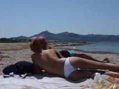 Blonde girl sucks dick at the beach