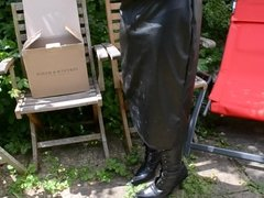 Wanking in the garden - in leather and boots