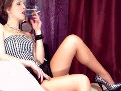 Smoking girl reclining + heels