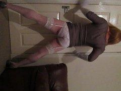 Posing in short dress, heels and lingerie