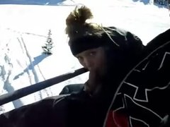 Sucking in chairlift in the air