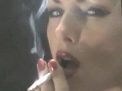 Smoking brunette in rubber
