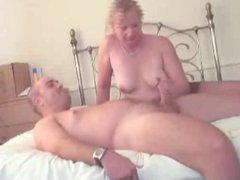 Milf plays with young guy