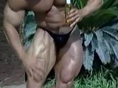 Bodybuilder oiling himself