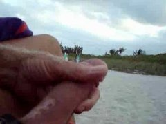 Wanking on the beach in front of black girls