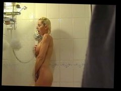 Voyeur catches Jane getting off in the shower.