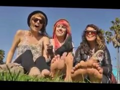3 girls remove their shoes to show their feet