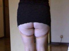 mini black dress ans stockings upskirt