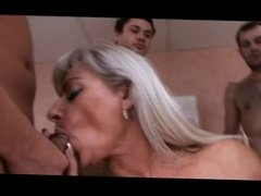 Mature lady gangbanged by young men