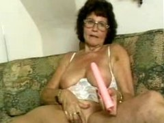 Granny in stocking dildoing her old pussy