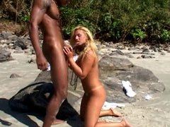 Whore gets fucked on the sand