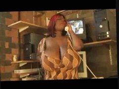 Black BBW on phone fondling her huge tits