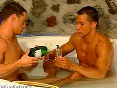 Muscle hunks relax in the hot tub