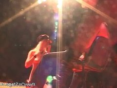 Two twin blonde strippers on stage teasing a horny guy