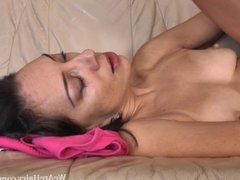 Eva plays with her hairy pussy