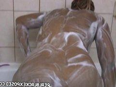 Voluptuous black slut in the shower