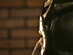 Leather Gloved Brunette Dominatrix Smoking Torture Up-Close