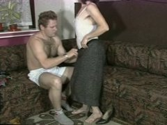 Hairy mature woman with saggy tits fucks on a couch