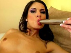 Adela fucks her cunt and ass with a silver vibrator