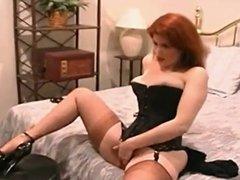 Redhead MILF fingers her juicy pussy