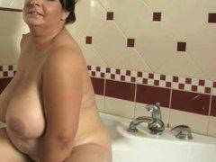 Busty milf in bathroom