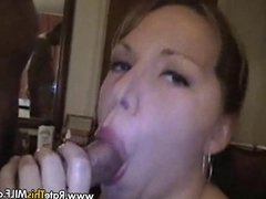 Super hot busty MILF sucking dick