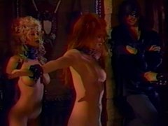 3 big tit lesbians in BDSM action while a guy watches on