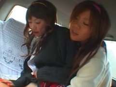 Two School girls In The Back Seat