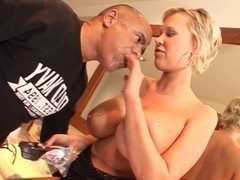 Guy  kisses naked blonde's stocking feet