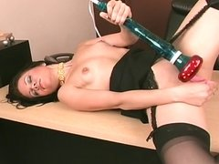 Hot brunette chick dildo fucks her pussy on the desk