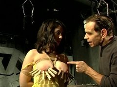 BDSM session involving a big tits hottie and her master