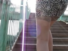 Girl in tan stockings going upstair
