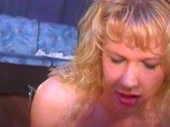 Hot blonde sucks on stiff dildo on the floor