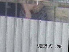crazy guy Jerks on the balcony. spycam