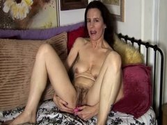 Mature amateur has a hairy pussy and a sexy bushy beaver