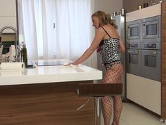 Damn hot mom grinding over the kitchen counter in sexy
