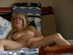 Hot blonde jumping on the bed for a hidden voyeur