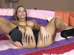 Satin stretched out by a brutal dildo