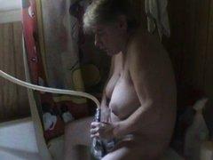 Hairy girl using showerhead