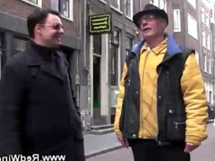 Host takes a tourist on a tour of the red light district