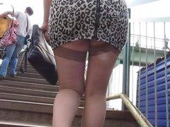 Girl in miniskirt and stockings going upstair