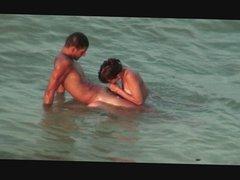 Peeking at nudists on the beach