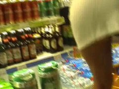 Upskirt Flash in a Supermarket, No Panties or Bra