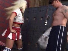 Sexy cheerleader doing handjob in handcuffs.