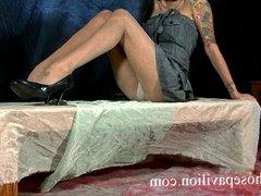 Petite tattooed Latina poses in pantyhose