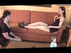 Female slave sucking mistress feet