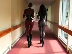 2 hot women in tight latex catsuits